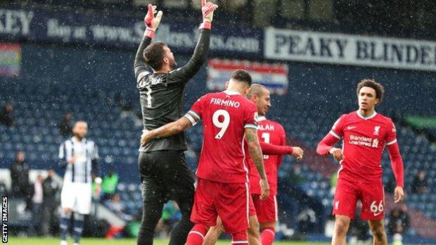 Alisson looks up to the sky after scoring
