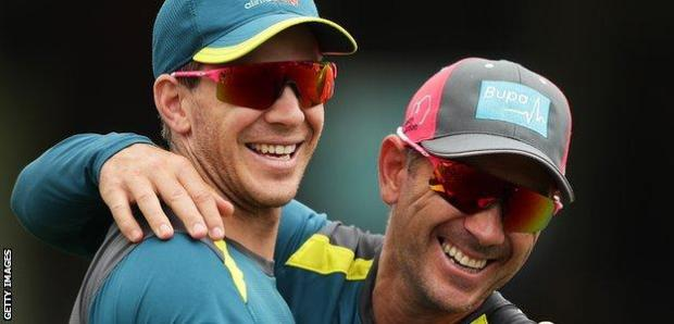 Tim Paine and Justin Langer share a joke