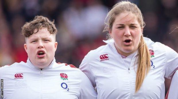 Hannah Botterman and Poppy Cleall singing the anthem
