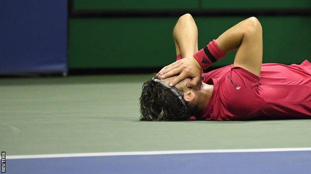 Dominic Thiem lying on court after winning the US Open title