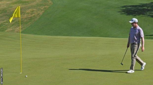 Robert MacIntyre looks at his ball on the 18th green in the WGC Matchplay