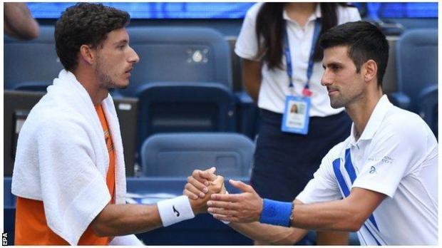 Novak Djokovic shakes hands after US Open default