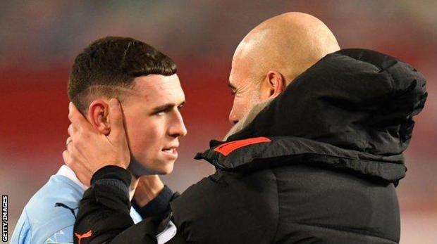 Manchester City boss Pep Guardiola and forward Phil Foden