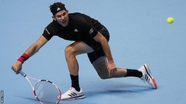 Dominic Thiem hits a return against Stefanos Tsitsipas at the 2020 ATP Finals