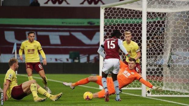 "Aston Villa""s Bertrand Traore shoots at goal in the Premier League match against Burnley"
