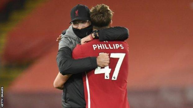 Jurgen Klopp hugs Nathaniel Phillips