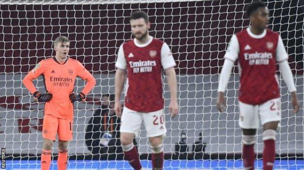 Arsenal's players reacts during their team's 4-1 defeat to Manchester City in the Carabao Cup