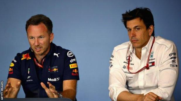 Cars: Red Bull team principal Christian Horner (left) and Mercedes F1 boss Toto Wolff (right) speaking at a news conference