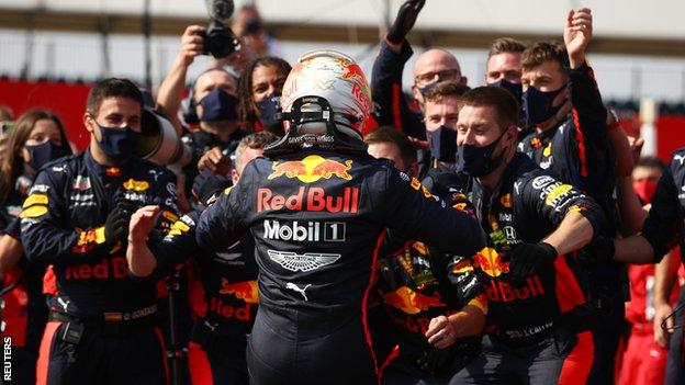 Verstappen celebrates with the Red Bull team