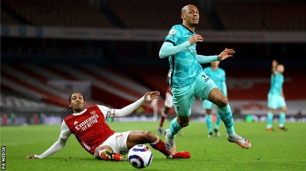 Fabinho (r) challenges Pierre-Emerick Aubameyang. He made six tackles in Saturday's win over Arsenal, twice as many as any other Liverpool player