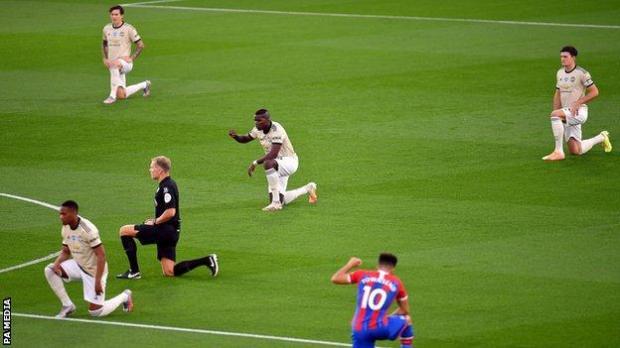 Premier League players take a knee