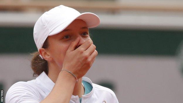 Iga Swiatek celebrates winning French Open title