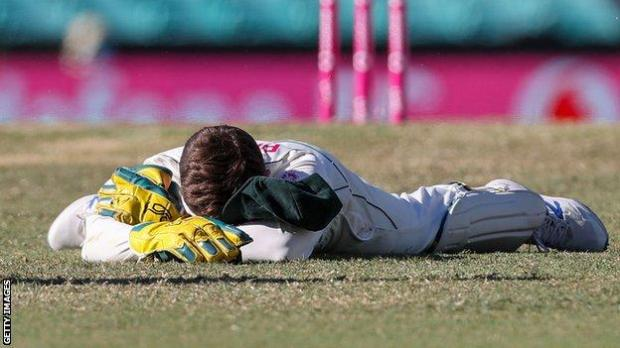 Tim Paine reacts after dropping Hanuma Vihari
