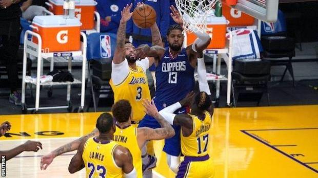 Paul George passes the ball at the net during the LA Clippers' win over the LA Lakers