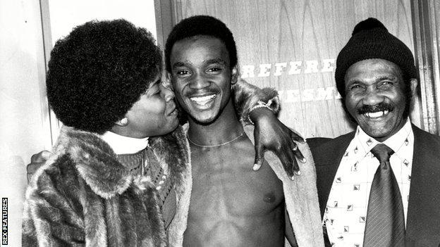 A young Laurie Cunningham, pictured with his mum Mavis and dad Elias
