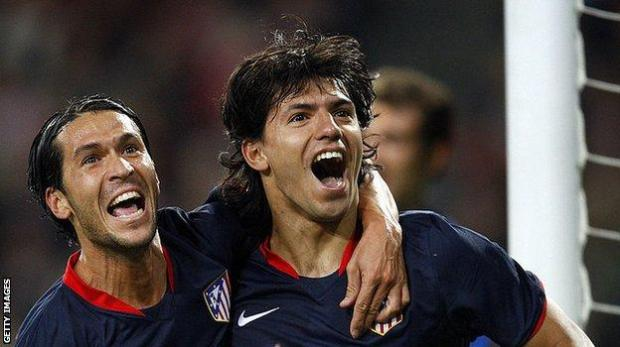 Where it all began: Aguero (r) celebrates with Luis Garcia after scoring his first Champions League goal, which came for Atletico Madrid against PSV in September 2008