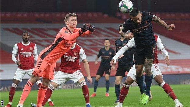 Manchester City's Gabriel Jesus heads his side's opening goal against Arsenal in the Carabao Cup
