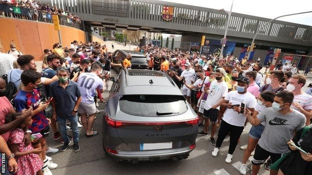 Fans gathered outside the Nou Camp for Lionel Messi's news conference on 8 August 2021