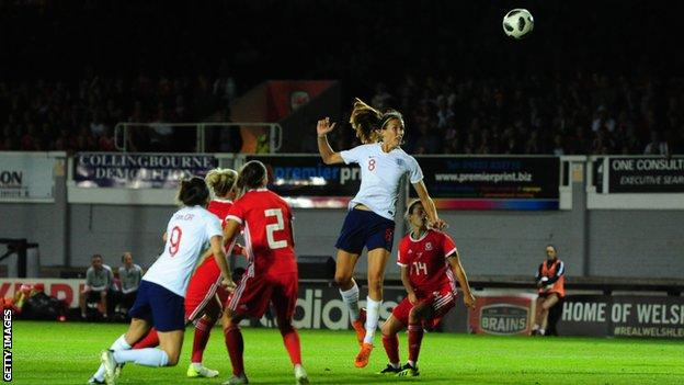 Jill Scott heads England's second goal
