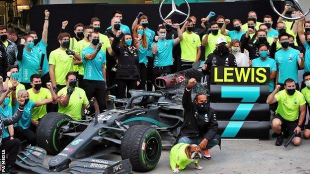 Lewis Hamilton celebrates winning his seventh world title