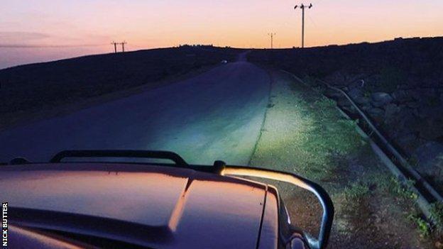 Car bonnet driving at dusk