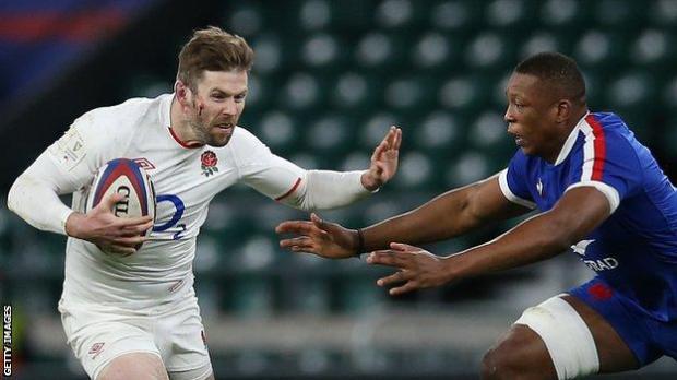 Elliot Daly hands off France's Cameron Woki