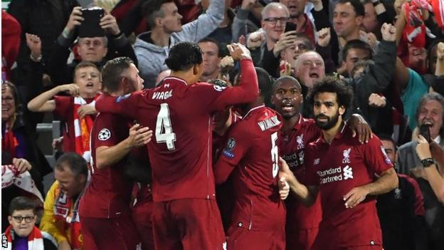 Liverpool's players celebrate scoring against Paris St-Germain in the Champions League