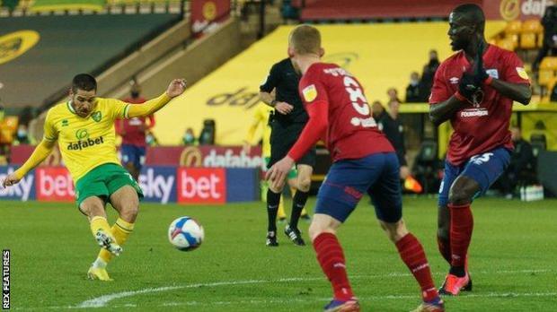 Emi Buendia scores Norwich's third goal against Huddersfield