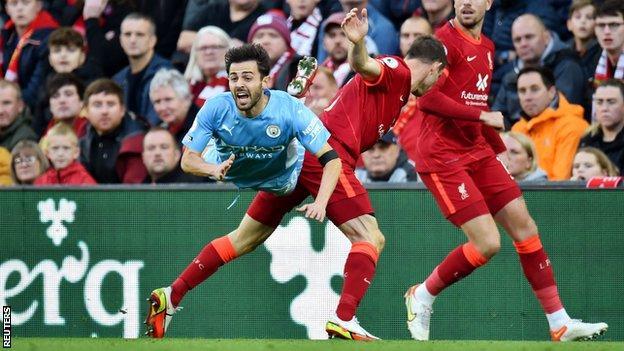 James Milner fouls Bernardo Silva at Anfield