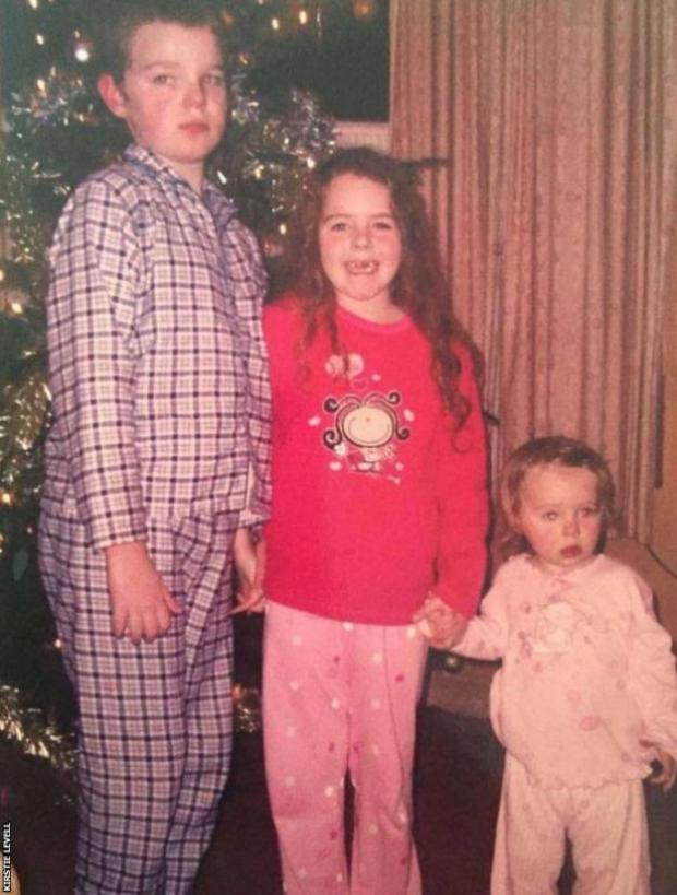Kirstie with her brother and sister at Christmas when they were children