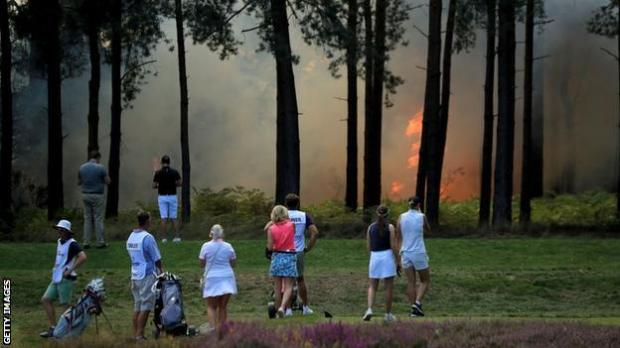 Players watch the fire at Wentworth