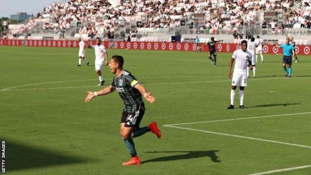 Javier Hernandez celebrates scoring