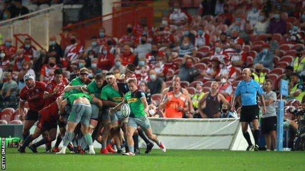 Gloucester face Harlequins in a Premiership rugby match at Kingsholm Stadium that saw 1,000 socially-distanced fans attend