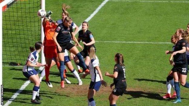 Chloe Kelly's left-wing corner went in off home keeper Becky Spencer for Man City's opener at The Hive