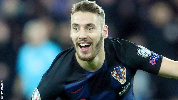 Nikola Vlasic of Croatia celebrates