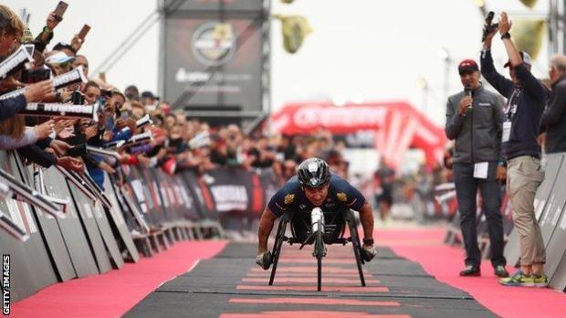 Alex Zanardi finishes a race