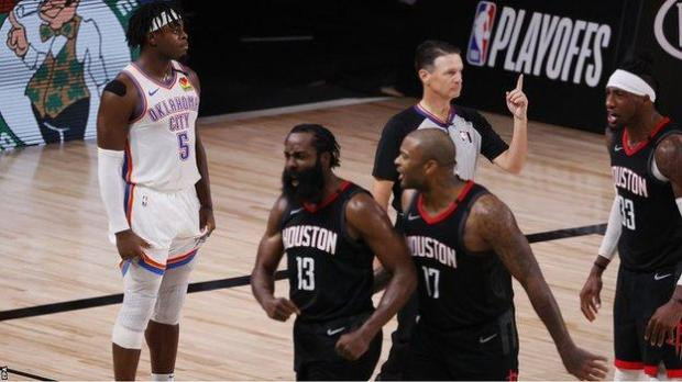 James Harden celebrates after blocking Luguentz Dort 's attempted three-pointer in the final seconds