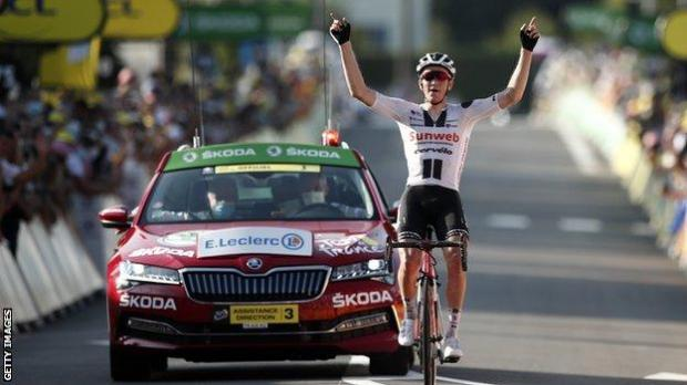 Sunweb's Soren Kragh Andersen raises his arms in celebration after winning stage 19 of the 2020 Tour de France