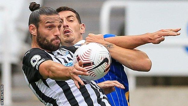 Andy Carroll in action for Newcastle against Brighton in the Premier League
