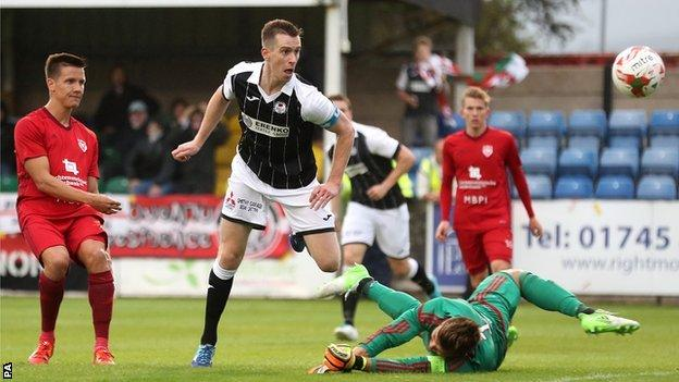 Chris Venables scores for Bala in the first leg at Rhyl's Belle Vue