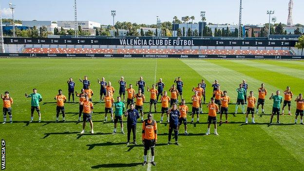Valencia players pose for photo alongside Diakhaby