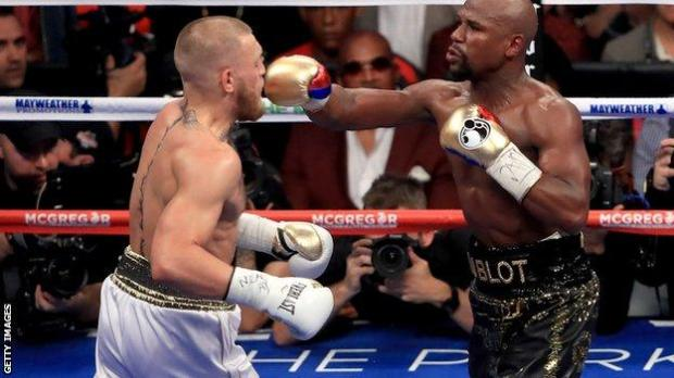 Floyd Mayweather (right) takes on Conor McGregor