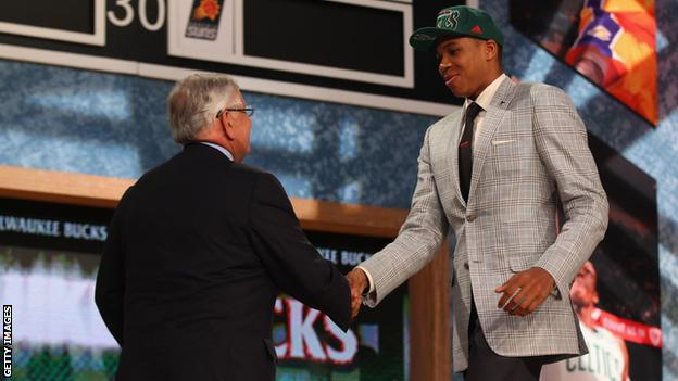 Giannis shakes hands with David Stern