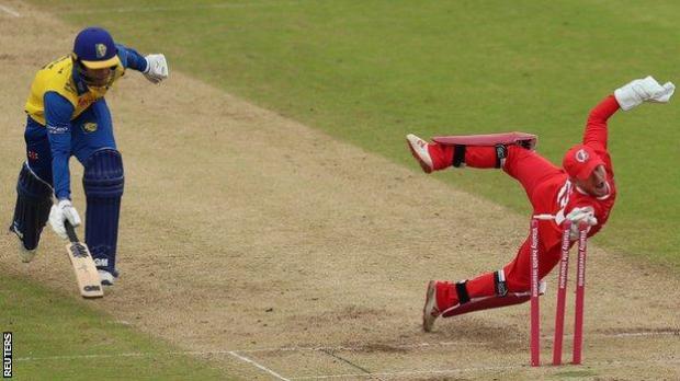 Lancashire's Alex Davies runs out Graham Clark of Durham
