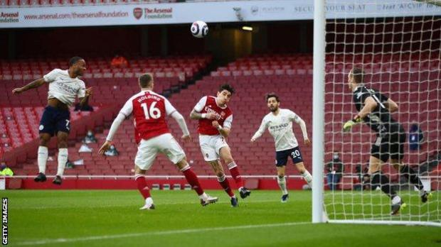 Raheem Sterling scores the opener for Manchester City at Arsenal