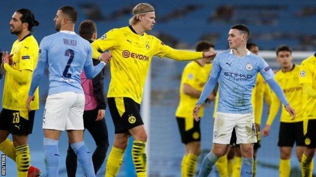 Erling Haaland and Phil Foden chat after the Champions League first leg