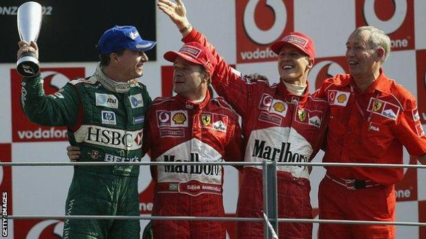 Eddie Irvine, Rubens Barrichello, Michael Schumacher and Rory Byrne in 2002