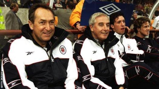 Gerard Houllier sits alongside Roy Evans