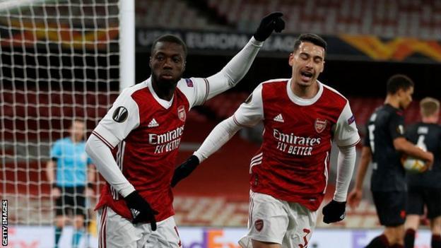 Arsenal's players celebrate scoring against Slavia Prague in the Europa League