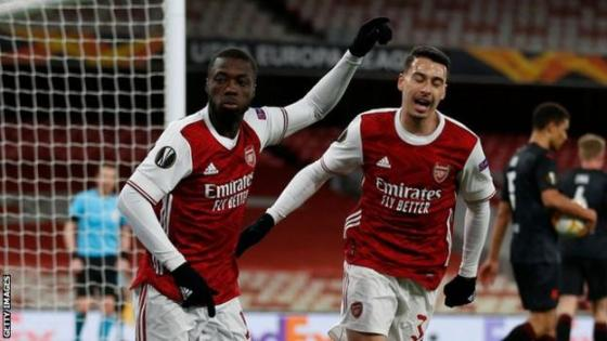 Arsenal players celebrate a goal against Slavia Prague in the European League